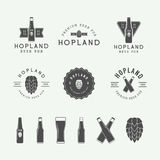Set of vintage beer and pub logos, labels and emblems with bottles, hops, and wheat Stock Photography