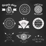 Set of vintage bike shop logos. White logo. Royalty Free Stock Photography