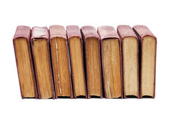 Set of vintage books with shabby brown cover, aged pages on a white background. Eight books. Soft focus Stock Image