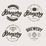 Set of vintage brewery badge, label, logo template designs. Set of vintage brewery badge, label, logo template designs with wooden barrels and hop for beer Royalty Free Stock Photography
