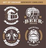 Set of vintage brewery emblems on dark background vector illustration