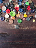 Set of vintage buttons on old wood Royalty Free Stock Photos