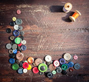 Set of vintage buttons on old wood Stock Photo
