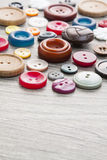 Set of vintage buttons. On old wooden table Stock Photo