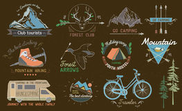 Set of vintage camping labels, logos, emblems and designed elements. Set of vintage camp and and outdoor adventure labels, logos, emblems and designed elements Royalty Free Stock Photos