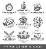 Set of vintage car service labels. Templates for the design of logos and emblems. Collection of car service symbols: tire, engine, muffler. Vector illustration Stock Photos