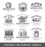 Set of vintage car service labels. Templates for the design of logos and emblems. Collection of car service symbols: tire, engine, muffler. Vector illustration Stock Image