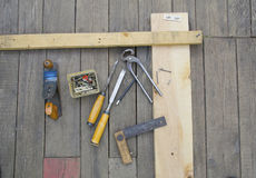 Set of vintage carpenter tools. On wooden floor Stock Photography