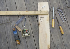 Set of vintage carpenter tools. On wooden floor Royalty Free Stock Photos