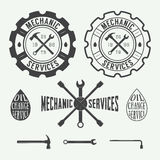 Set of vintage carpentry and mechanic labels, emblems and logo royalty free illustration