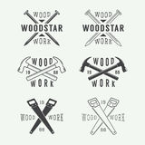 Set of vintage carpentry and mechanic labels, emblems and logo Royalty Free Stock Photo