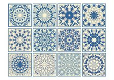 Set of vintage ceramic tiles in azulejo design with blue patterns on beige background, traditional Spain and Portugal pottery Royalty Free Stock Photography
