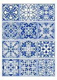 Set of vintage ceramic tiles in azulejo design with blue patterns on white background  Royalty Free Stock Photography