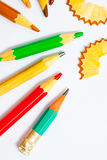 Set of vintage colored pencils with chips. On white background Stock Photos