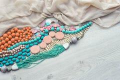 Set of vintage costume jewellery beads, necklaces, bracelets, scarf. Stock Photo