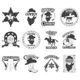 Set of vintage cowboy emblems, labels, badges, logos and designed elements. Wild West theme. Monochrome style Royalty Free Stock Photography
