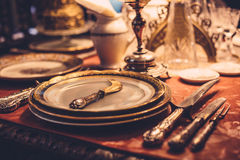 Set of vintage dinnerware on red table Stock Image