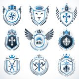 Set of  vintage emblems created with decorative elements l. Set of vintage emblems created with decorative elements like crowns, stars, bird wings, armory and Stock Photo