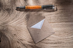 Set of vintage envelope fountain pen on wooden board Royalty Free Stock Image