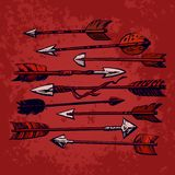 Set of 9 vintage ethnic indian arrows isolated on red old shabby background. Hand drawn vector illustration in boho royalty free illustration