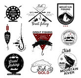 Set of vintage fishing logo, labels, emblems and designed elements. Stock Photo