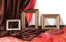 Set of vintage frames on textile background. Set of vintage golden frames on textile background Royalty Free Stock Photos