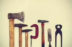 Set of vintage hand construction tools on a white wooden background royalty free stock photos