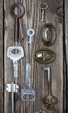 Set of vintage keys and keyholes Royalty Free Stock Photography