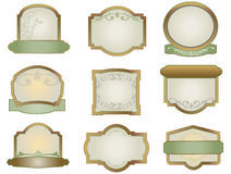 Set of vintage labels for design. Vector green and bronze shields with filigree and leaves Royalty Free Stock Images