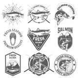 Set of vintage labels with salmon fish. Salmon fishing, salmon m. Eat. Design elements for label, emblem for fishing club. Vector illustration Royalty Free Stock Photography