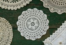 Vintage lace napkins on rusted wooden background stock image