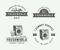 Set of vintage laundry, cleaning or iron service logos, emblems, Royalty Free Stock Photo