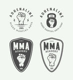 Set of vintage mixed martial arts or fighting club logos, emblem. S, badges, labels, marks and design elements. Retro graphic art. Vector Illustration Royalty Free Stock Photos