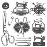 Set of vintage monochrome tailor tools and emblems. Royalty Free Stock Photo