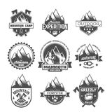 Set of vintage mountain explorer labels. Set of mountain adventure and travel retro emblems. Black and white mountain shields. Camping badges travel logo emblems Stock Image