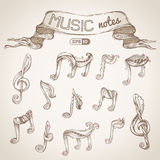 Set of vintage music symbols. Vector hand-drawn sketch. Music notes and treble clefs Royalty Free Stock Image