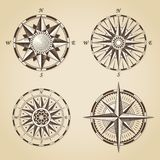 Set of vintage old antique nautical compass roses. Vector signs. Labels emblems Royalty Free Stock Photos