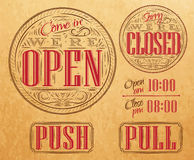 Set vintage open closed kraft. Set of vintage symbol lettering come in we're open, sorry we're closed, push, pull style drawing on kraft paper of red, brown Stock Photos