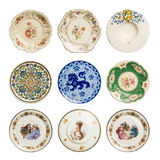 Set of vintage plates. Set of decorative vintage plates with different designs, white background stock photos