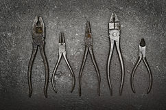 Set of Vintage Pliers. Set of Five Vintage Pliers on a background of concrete Royalty Free Stock Photos