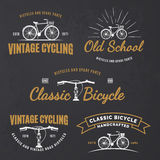 Set of vintage road bicycle emblems. Set of vintage road bicycle labels, emblems, badges or logos on grunge black background. Handcrafted bicycle repair royalty free illustration