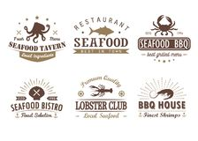 Set of vintage seafood, barbecue,  logo templates Royalty Free Stock Images