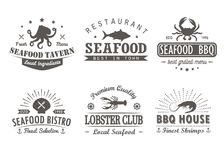 Set of vintage seafood, barbecue, grill logo templates, badges and design elements. Royalty Free Stock Images