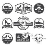 Set of vintage shoes repair labels, emblems and designed element Royalty Free Stock Images