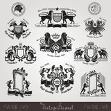 Set vintage silhouette heraldic labels with pattern and animals Royalty Free Stock Photo