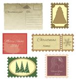 Set of vintage stamps and vintage postcard. Royalty Free Stock Photo