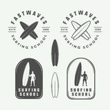 Set of vintage surfing logos, emblems, badges, labels. And design elements. Vector Illustration Stock Photos