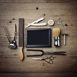 Set of vintage tools of barber shop with black picture frame Stock Photos