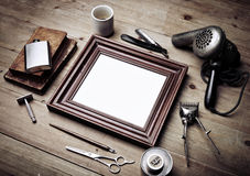 Set of vintage tools of barber shop and black picture frame Royalty Free Stock Photography