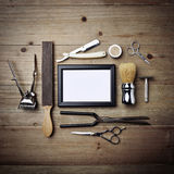 Set of vintage tools of barber shop with empty picture frame. Set of vintage tools of barber shop and white frame Royalty Free Stock Photography